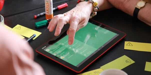 Hands using a tablet